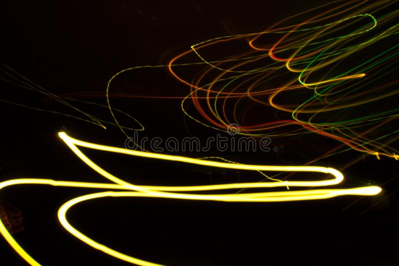 Abstract beautiful light painting photography, waves abstract light on black background royalty free stock photos