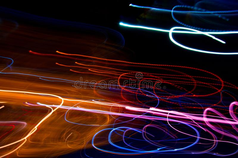 Abstract beautiful light painting photography, waves abstract light on black background stock photo