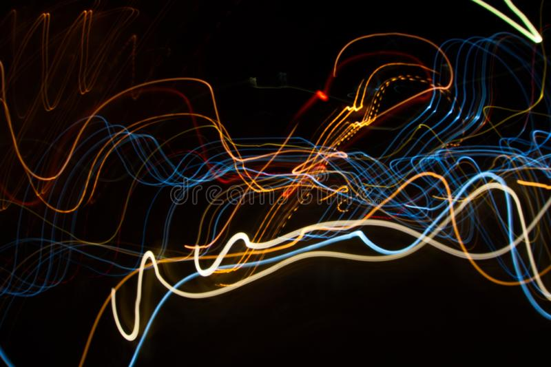 Abstract beautiful light painting photography, waves abstract light on black background stock image