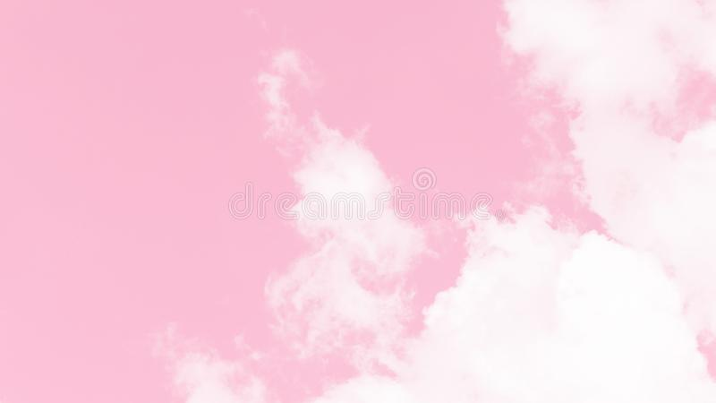 Abstract beautiful view of white fluffy clouds on a soft pastel pink sky background. Abstract sky in sweet color. Abstract in blur stock images