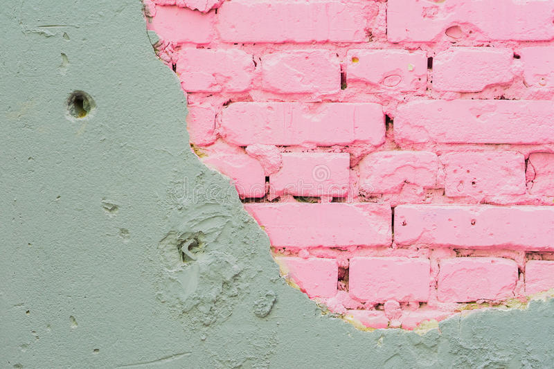 Abstract beautiful wall of grey cement and pink bricks. Rough damaged shabby texture with cracked. With place for text. Abstract beautiful wall of grey cement stock photos