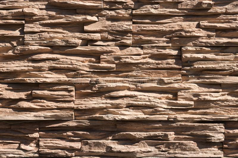 Abstract beige brown slate pattern stone block wall texture for background and wallpaper large and wide modern stone. Wall facade royalty free stock images