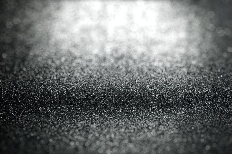 Abstract black glitter lights background with surface texture focused royalty free stock photo