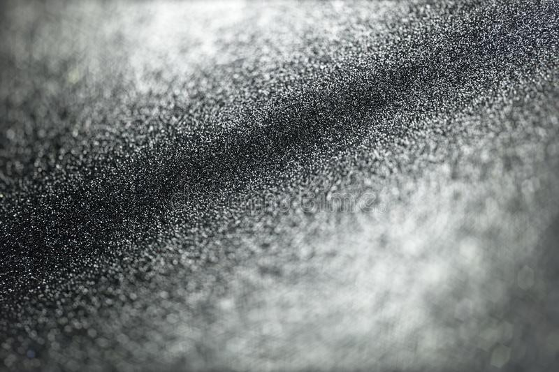Abstract black glitter light background with selective focus inclined plan stock photography