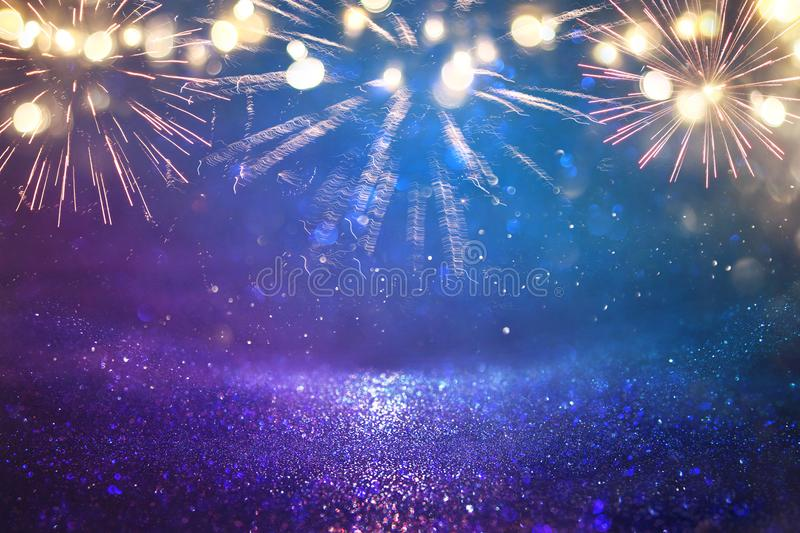 Abstract black, gold and blue glitter background with fireworks. christmas eve, 4th of july holiday concept. Abstract black, gold and blue glitter background stock photo