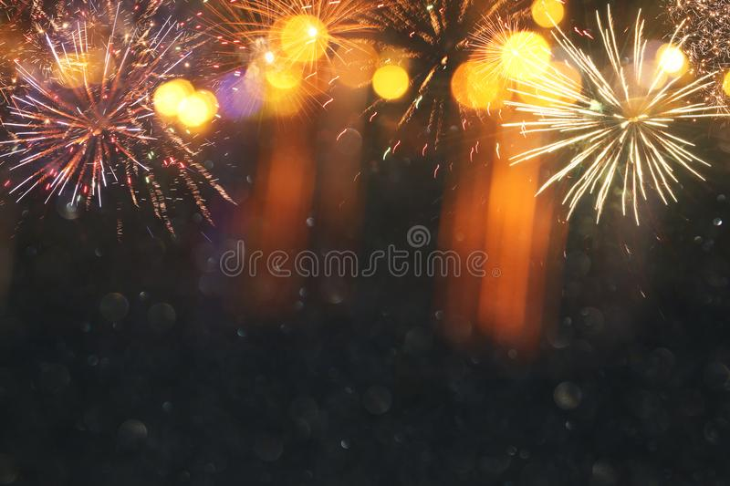 abstract black and gold glitter background with fireworks. christmas eve, 4th of july holiday concept. royalty free stock photography