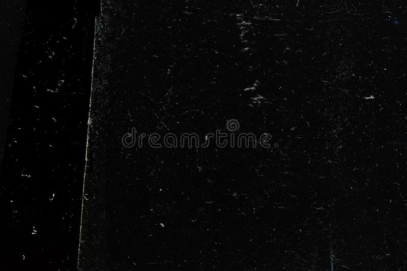 Abstract black grunge background-texture, worn old surface. Abstract black background with vintage grunge texture design, old rough banner paper royalty free stock images