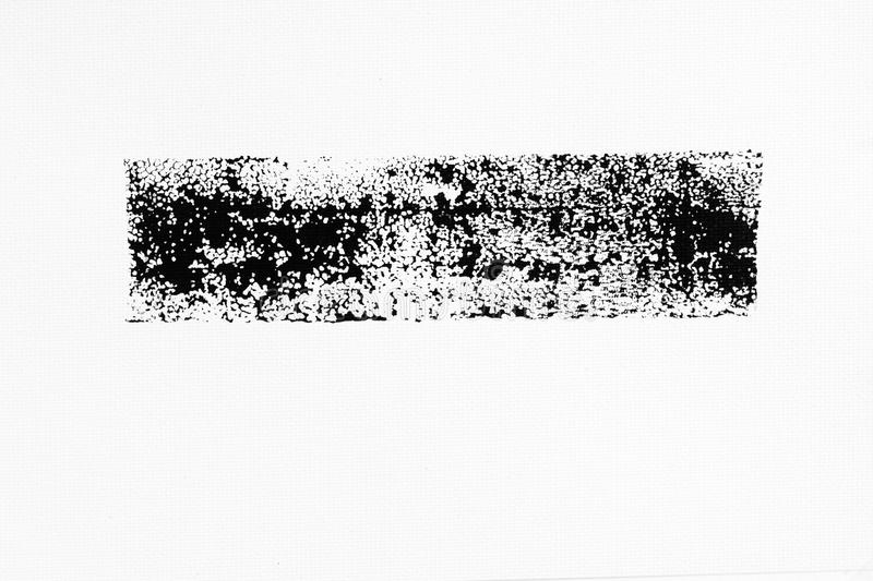 Abstract black ink splash on white paper. Grunge textured for abstract stock template. Black liquid splattered on white background royalty free stock photos