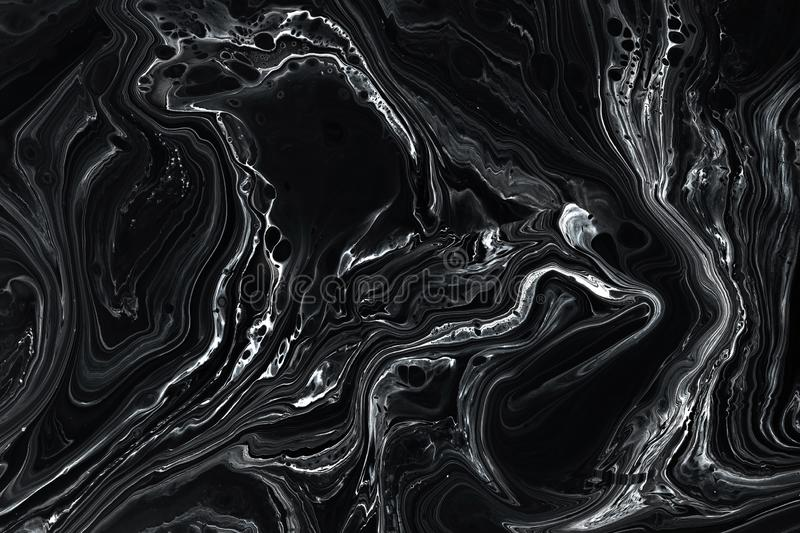 Abstract black marble texture background. Oil, acrylic paint mix pattern. stock photography