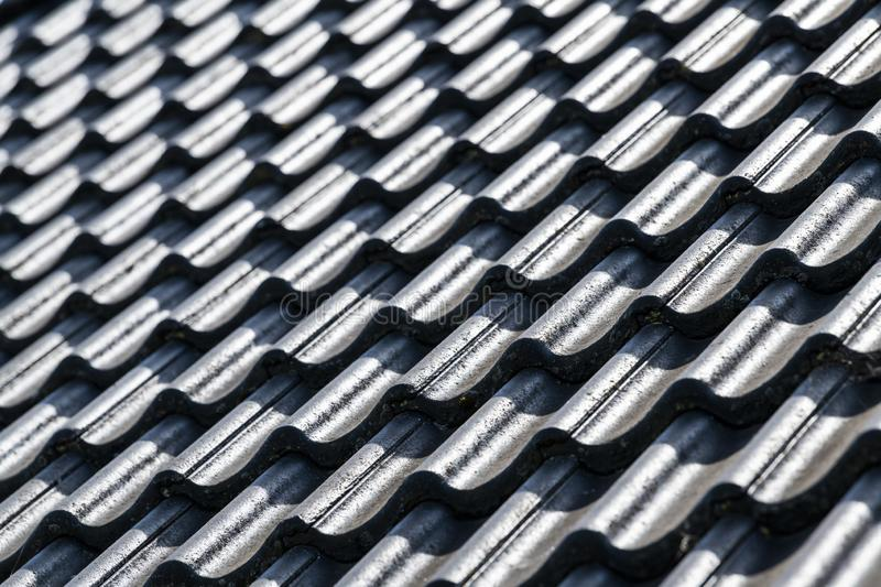 Abstract black roof with concrete tiles royalty free stock image