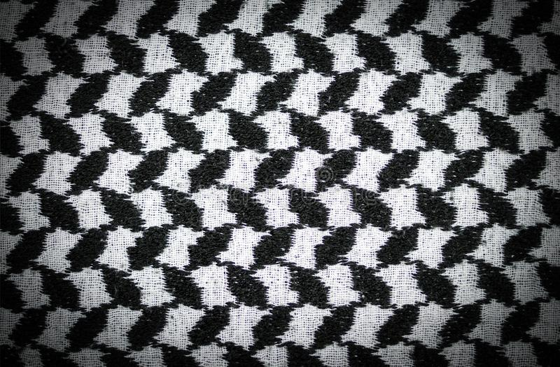 Black and white arabic style fabric textile with vignette. background, texture. Abstract black and white arabic style fabric textile with vignette. background royalty free stock photo
