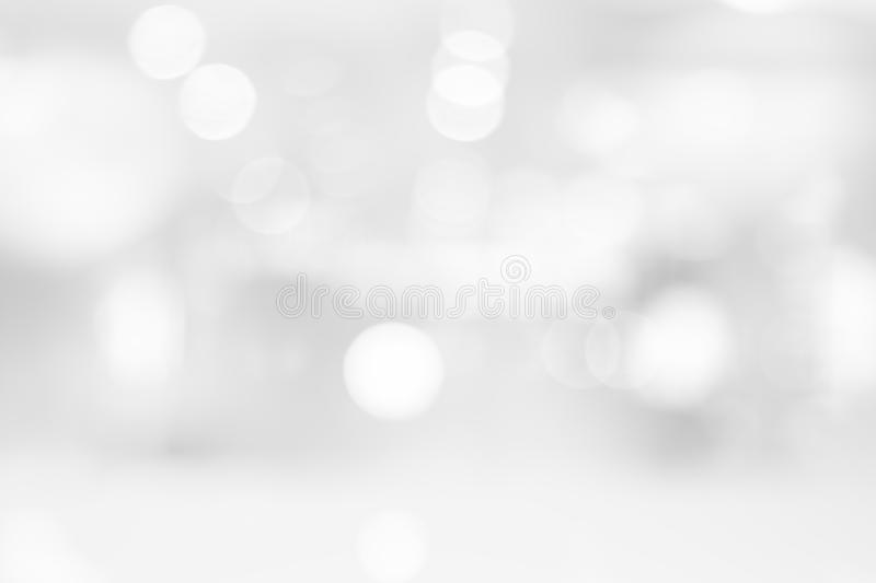 Abstract black and white bright bokeh background with white table top for backdrop design, bokeh composition for. Website, magazine or graphic for commercial stock photography