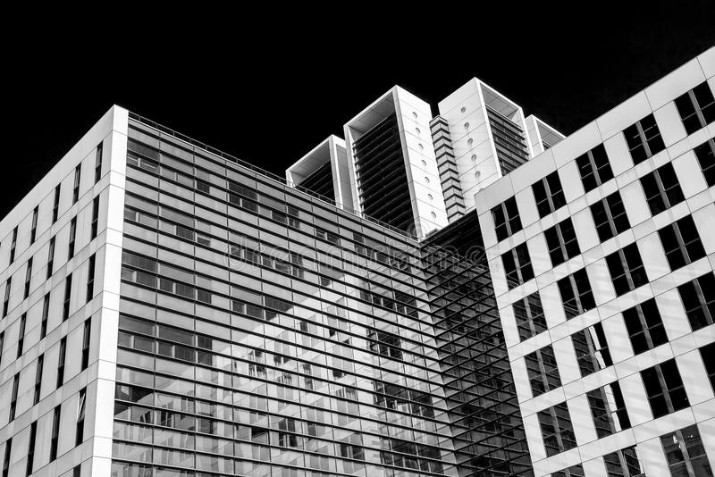 Abstract black and white image of glass skyscraper office buildings royalty free stock photos