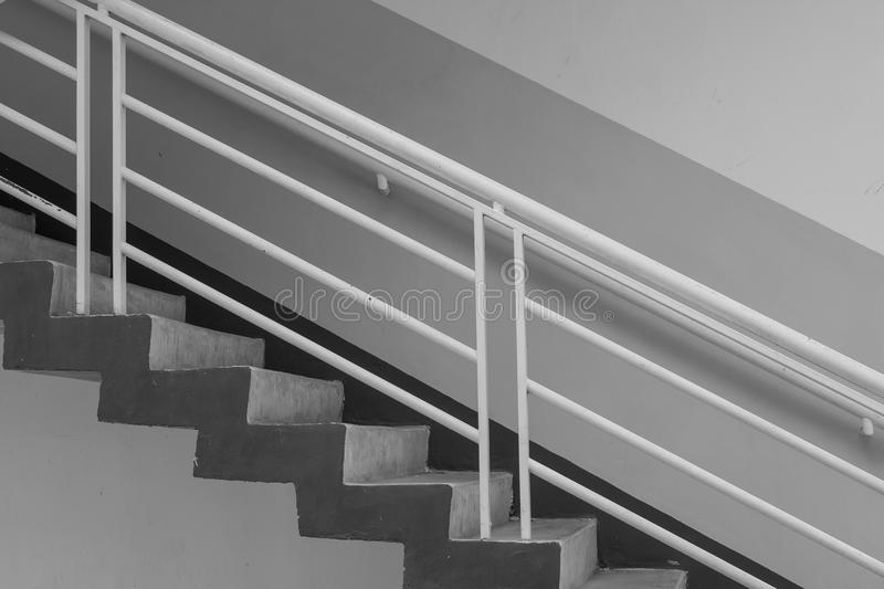 Abstract black and white image side view of architecture staircase outside of buildings. Selective focus royalty free stock images