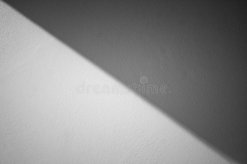 Abstract Black and White image of sunlight shading shadow on white concrete wall at outside of buildings. Selective focus stock images