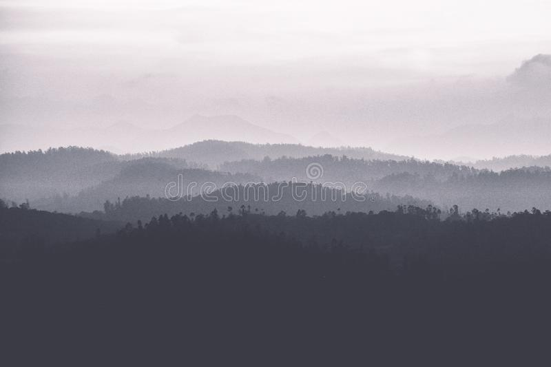 Abstract black and white landscape of mountains stock photos