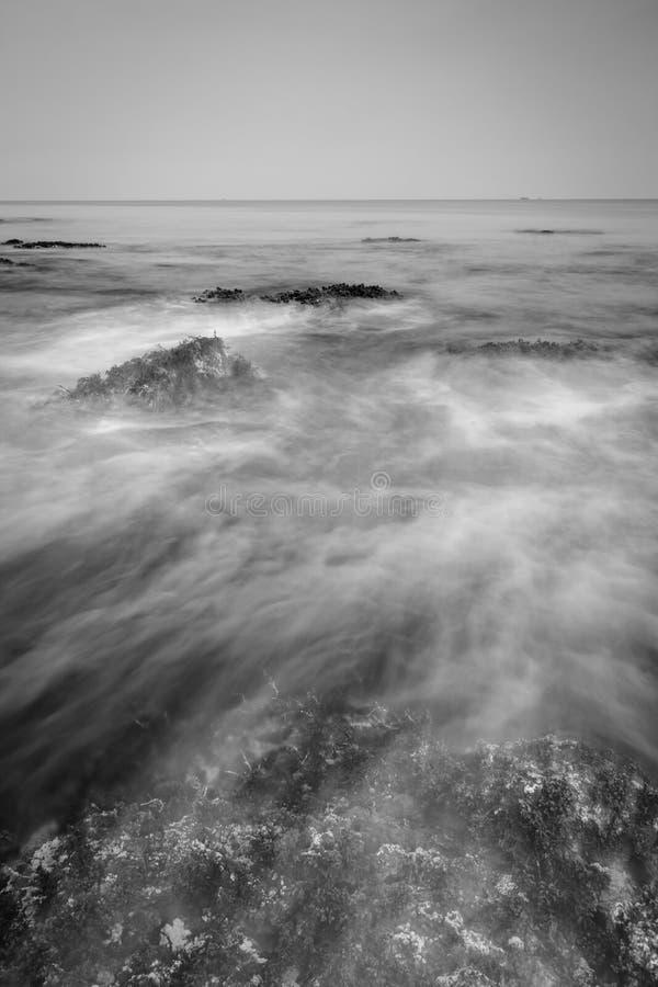 An abstact long exposure sea wave. An abstract black and white long exposure sea wave at Mutiara Carita Beach royalty free stock photography