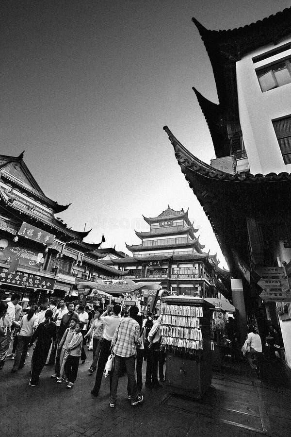 Abstract black and white with noise and grain photo of Yuyuan ga. Shanghai China - May 5, 2006: Abstract black and white with noise and grain photo of Yuyuan royalty free stock photo