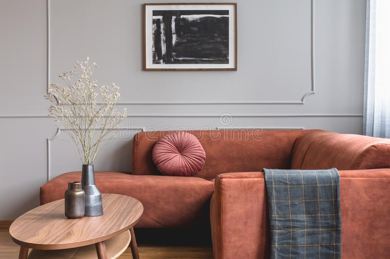 Abstract black and white painting on grey empty wall of contemporary living room interior stock image