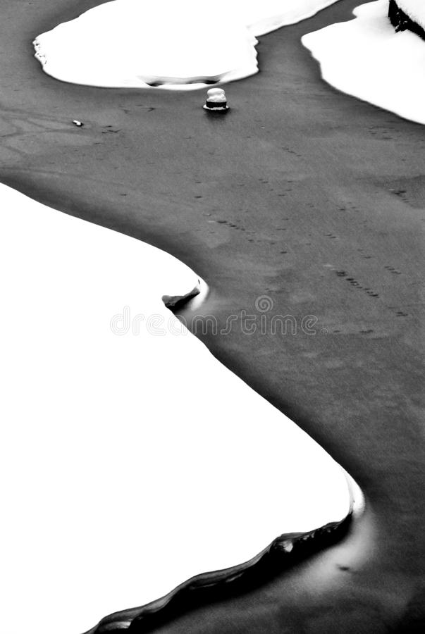 Abstract black and white photo of iced river stock photography