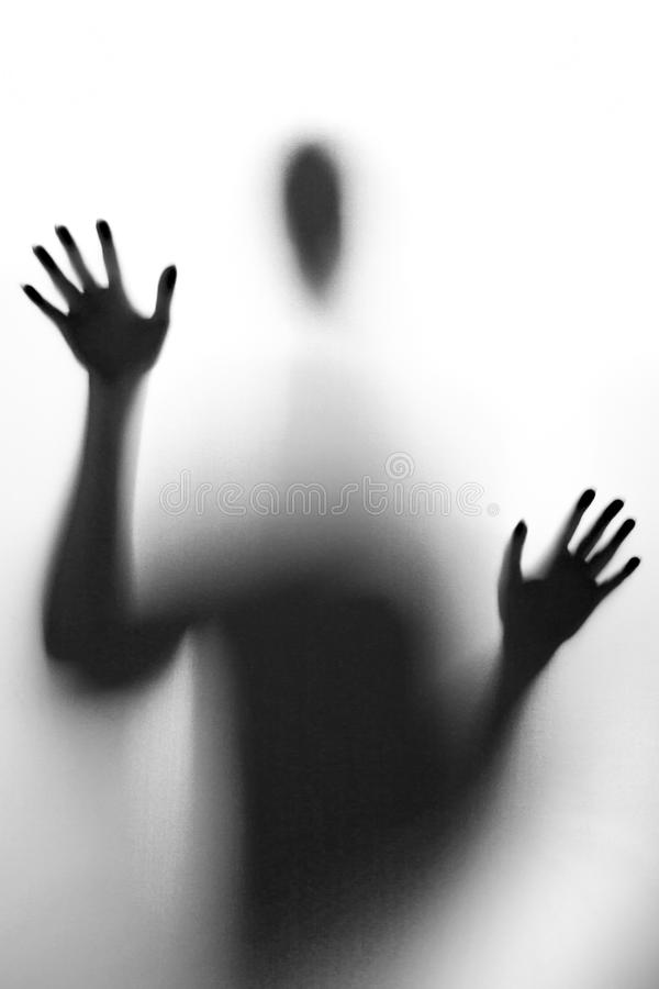 An abstract black-and-white portrait of a man. Dark silhouette on a light background royalty free stock photo