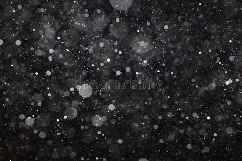 Abstract black white snow texture on black background royalty free stock photography
