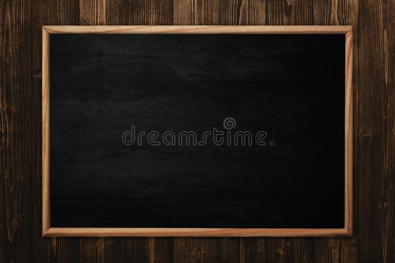 Abstract blackboard or chalkboard with frame on wooden background royalty free stock photos