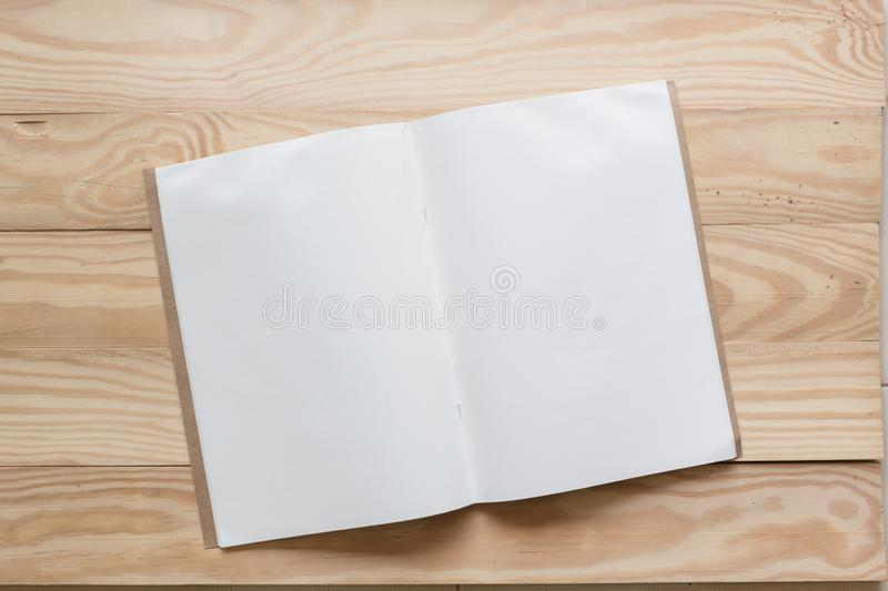Abstract Blank one white paper on wooden table top view background concept for empty letter business sheet, plain brochure mock up. Template, flyer card stock images