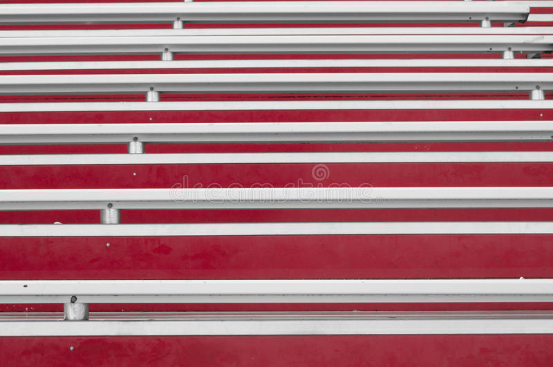 Abstract Bleachers. Abstract view of red painted bleachers with white silver metal royalty free stock photo
