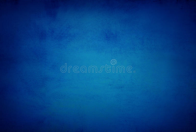 abstract blue background or dark paper with bright center spotlight and black vignette border frame with vintage grunge royalty free stock photo