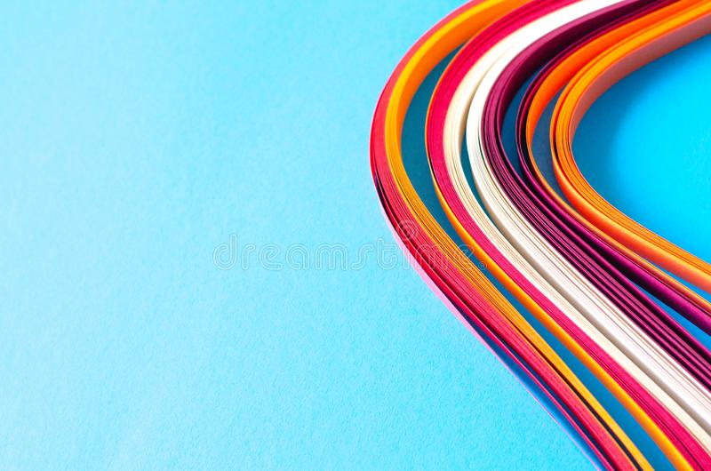 Abstract blue background with orange, burgundy and white stripes royalty free stock photos