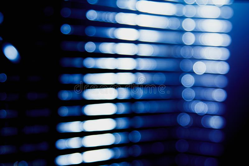 Abstract blue blur of city lighting digital lens flare glare, blinds light background royalty free stock photography