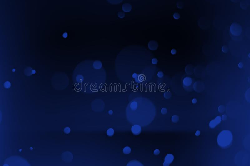 Abstract. Blue bokeh background on a black scene stock photography