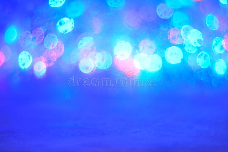 Abstract blue bokeh lights background. Blurred colored lights garlands. Beautiful Christmas and New Year background royalty free stock photography