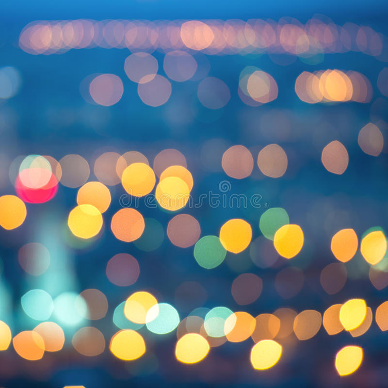 Abstract blue circular bokeh background, city lights with horizon, instagram toned effect, closeup royalty free stock photography