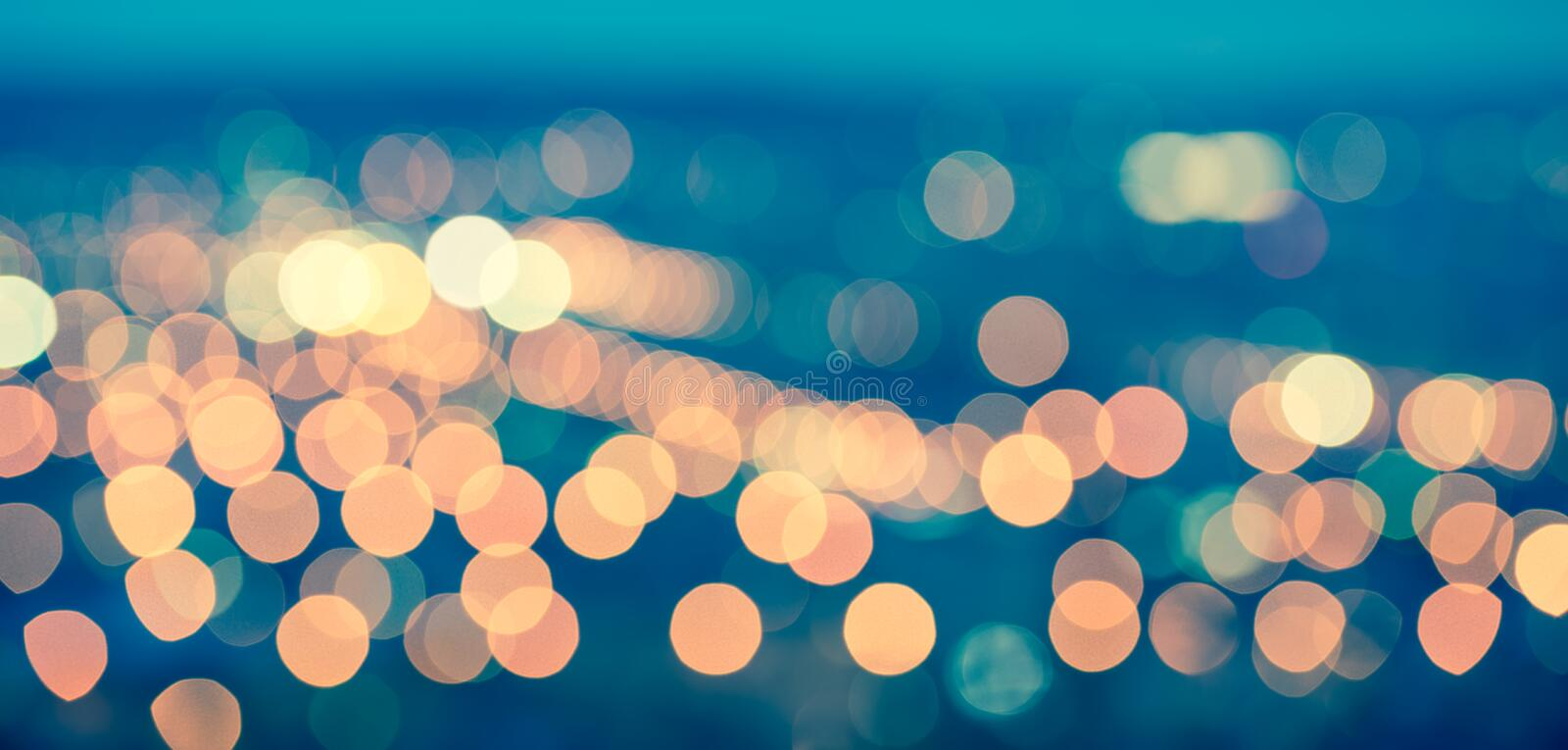 abstract blue circular bokeh background, city lights with horizon, toned style, panorama stock illustration