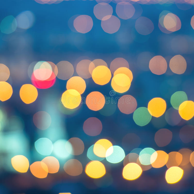 Abstract blue circular bokeh background, city lights, instagram toned effect, closeup royalty free stock photography