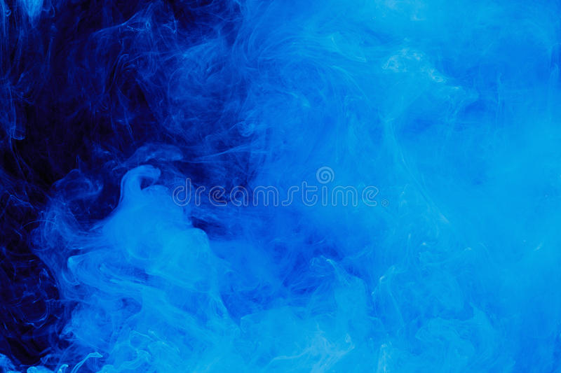 Abstract blue cloud pattern of white smoke on a black background. stock photography