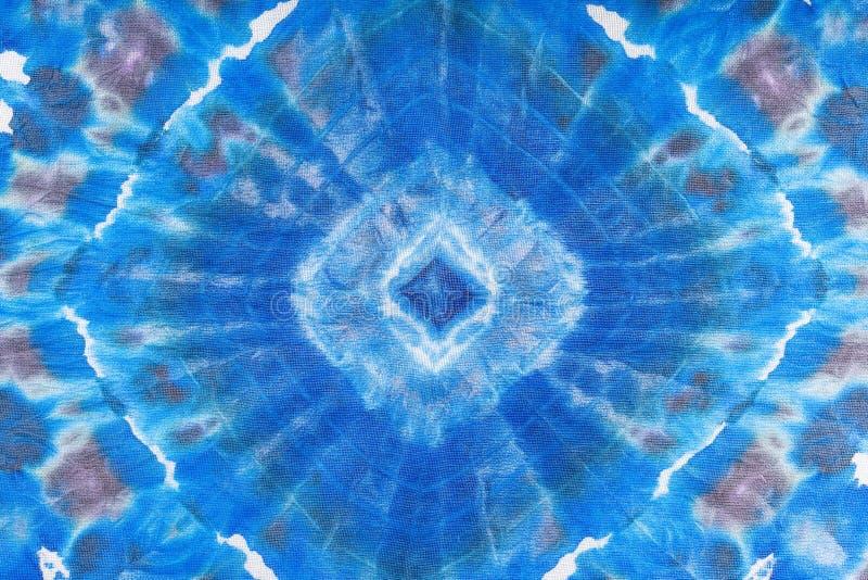 Abstract blue geometric ornament on silk batik. Textile background - abstract blue geometric ornament hand painted in nodular technique on silk batik stock image