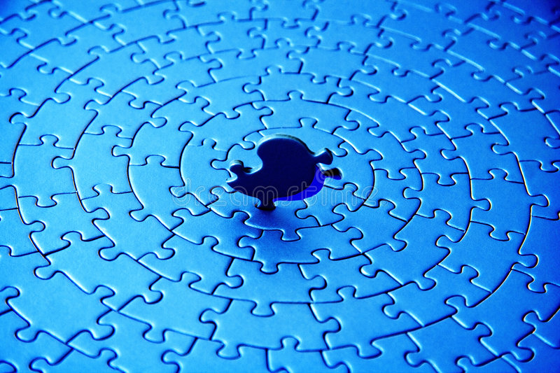 Abstract of a blue jigsaw with the last piece upstanding stock photography