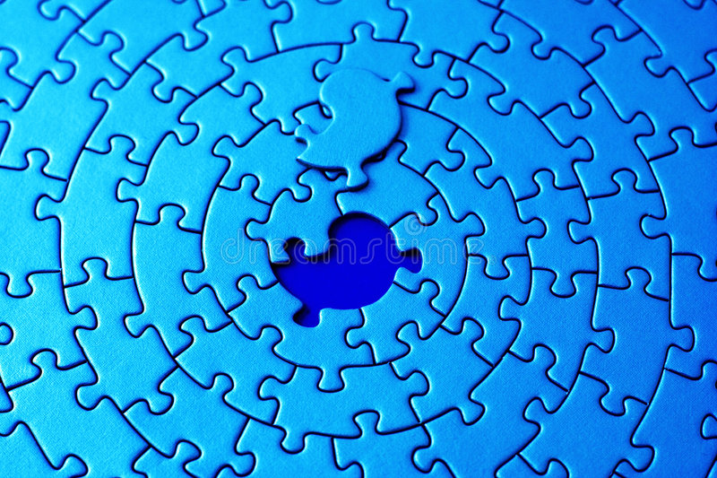 Abstract Of A Blue Jigsaw With The Missing Piece Laying Above The Space Stock Photo