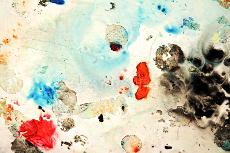 Abstract blue orange black spots, painting watercolor background, painting abstract colors. Abstract spots background and colors, in black red blue orange dark royalty free stock image