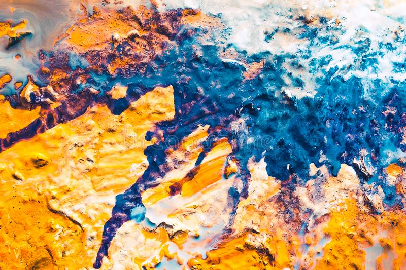 Abstract blue orange fantasy cake paint background. Abstract art texture background. Fantasy cake with glazed top and sugar powder. Orange and blue paint splash royalty free stock photos