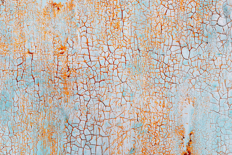 Abstract blue orange texture with grunge cracks. Cracked paint on a metal surface. Bright urban background with rough paint transitions. The cracks grunge stock images