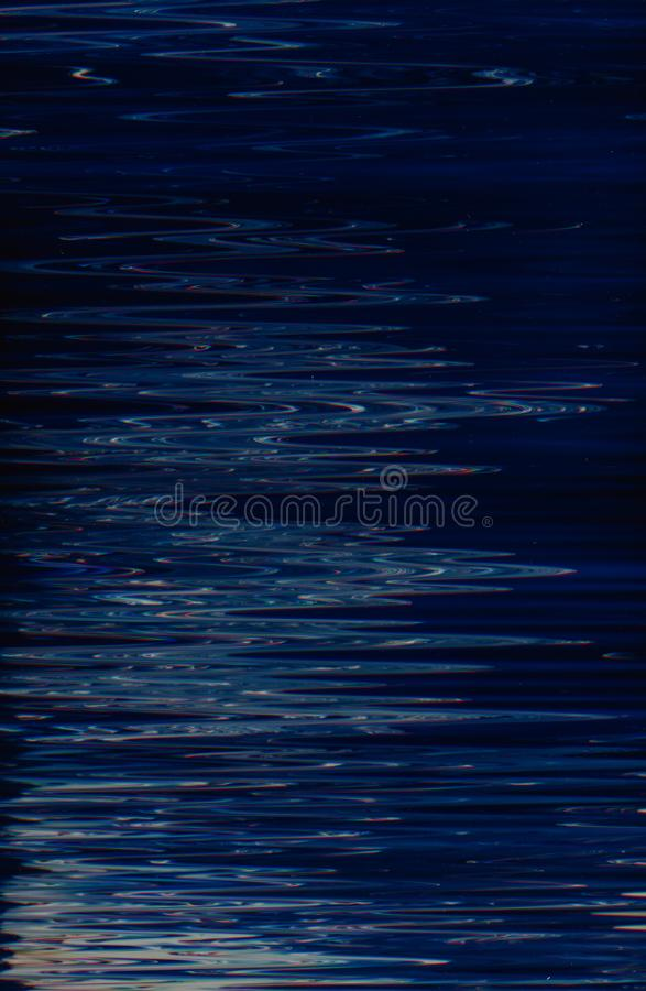Abstract blue paint background fluid water ripples. Abstract dark blue paint background. Moonlight effect liquid fluid surface. Water expanse. Zigzag ripples stock photography