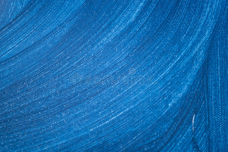 Abstract blue painting with waves of color stock photography