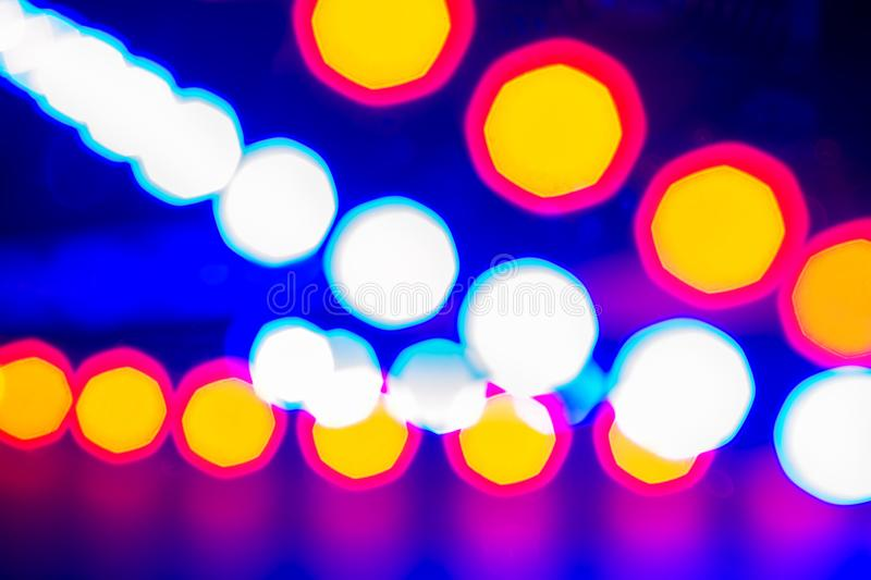 Abstract Blue Pink yellow bokeh lights and reflections. Festive background of 80s colors stock photography