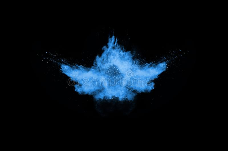 Blue color powder explosion on black background. royalty free stock photography