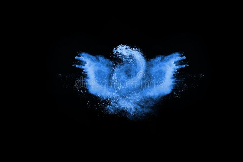 Blue color powder explosion on black background. Abstract blue powder splatted background,Freeze motion of color powder exploding/throwing color powder,color stock images