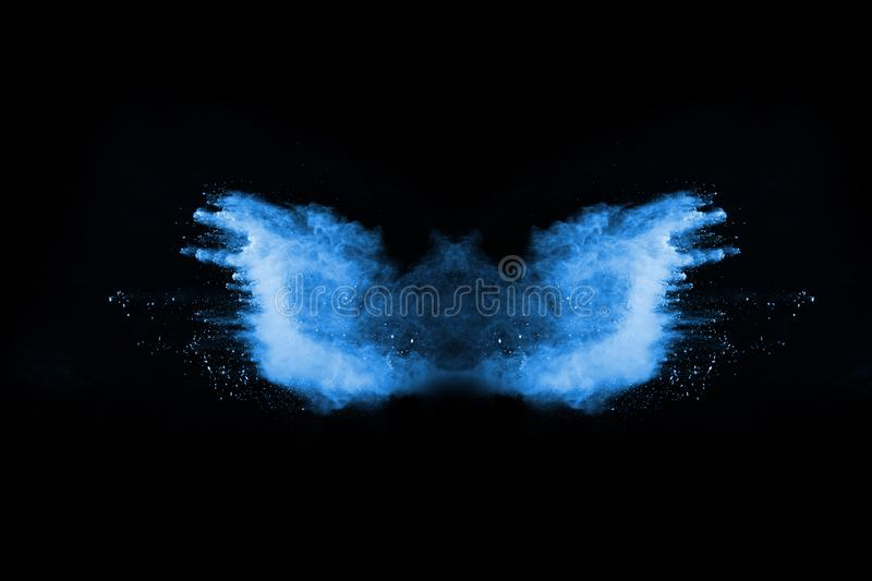 Blue color powder explosion on black background. royalty free stock image